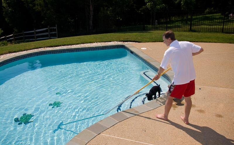 man cleaning the pool